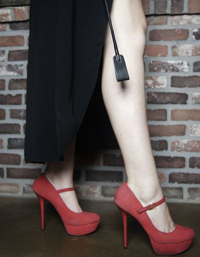 Low section of woman in high heels