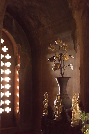 Close-up of illuminated statue in temple