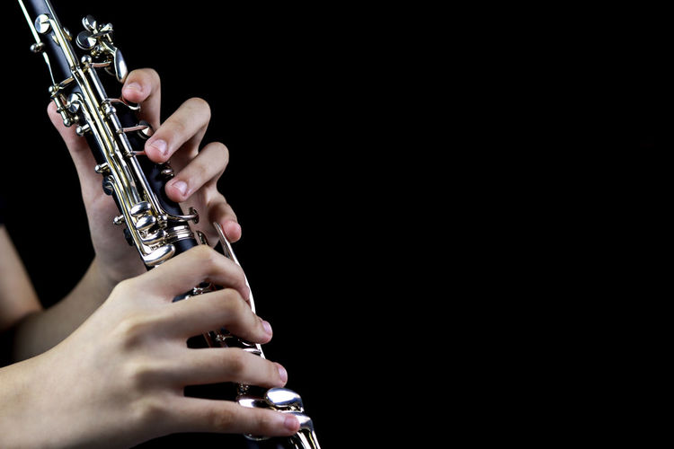 Music Instrument Clarinet Player, Clarinet Player Isolated on black Music Musical Instrument Arts Culture And Entertainment Studio Shot Black Background Human Hand Indoors  Musician Artist Hand Copy Space Human Body Part Performance Holding One Person Wind Instrument Playing Close-up Metal Finger