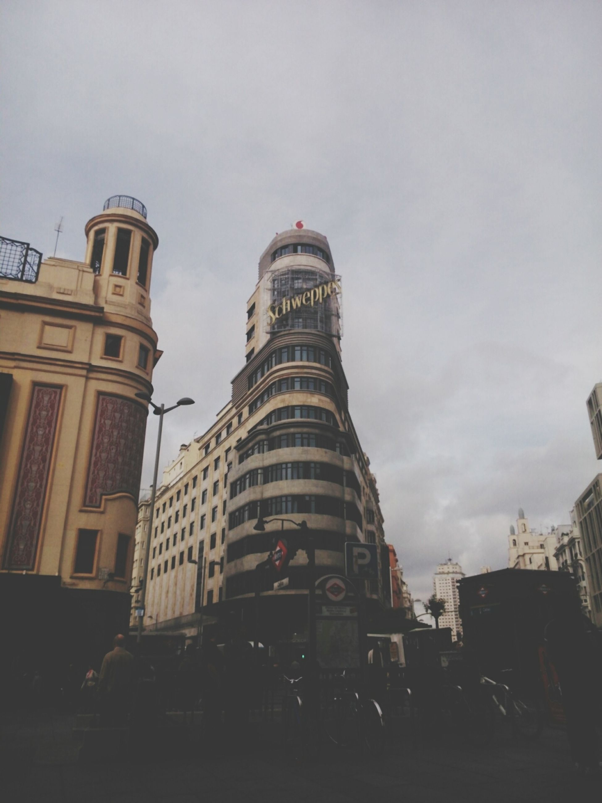 architecture, building exterior, built structure, city, sky, tower, low angle view, tall - high, building, city life, car, travel destinations, capital cities, transportation, street, skyscraper, travel, land vehicle, famous place, office building