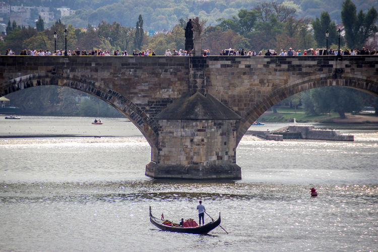 Bridge Bridge - Man Made Structure Architecture Water Transportation Built Structure Connection River Real People Arch Mode Of Transportation Men Arch Bridge Nature Travel Nautical Vessel Day Incidental People Group Of People Outdoors