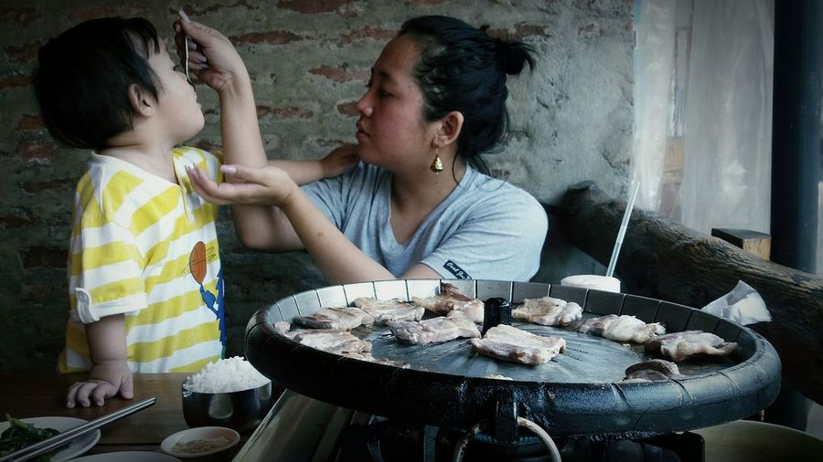 Meal time bonding.. ShareTheMeal Mother Toddler  Mommy&Son Mealtime Bonding Motherhood Togetherness Family Domestic Life HappyTummy Happybaby Lifestyles Food And Drink Asian Family Koreanfood Tired Mommy Motherhood Above Everything Else Responsibility Motherhood Moments Outdoors Leisure Activity Happiness Childrenoftheworld Savethechildren