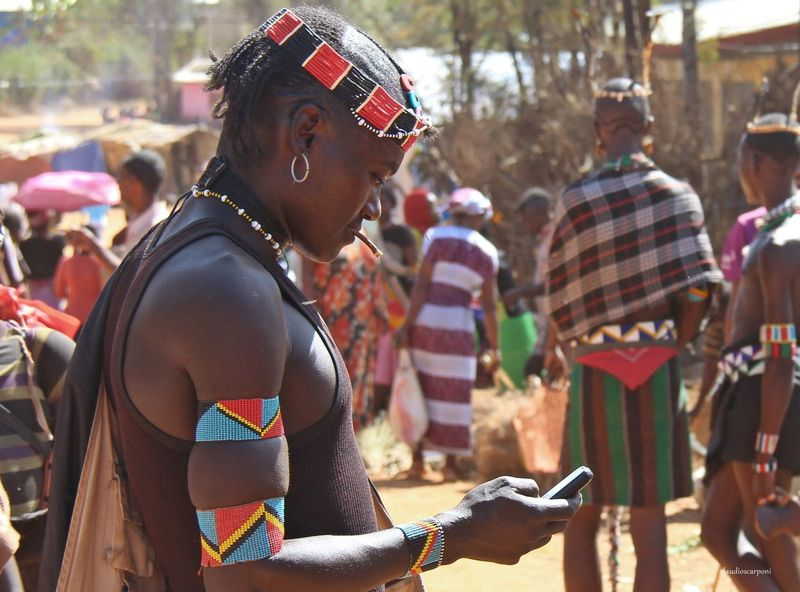 Banna Casual Clothing Communication Day Ethiopia EyeEm Selects Focus On Foreground Holding Incidental People Indigenous People Key Afer Lifestyles Market Omovalley One Person Outdoors People Real People Standing Technology Tribesmen Wireless Technology Young Adult Young Women