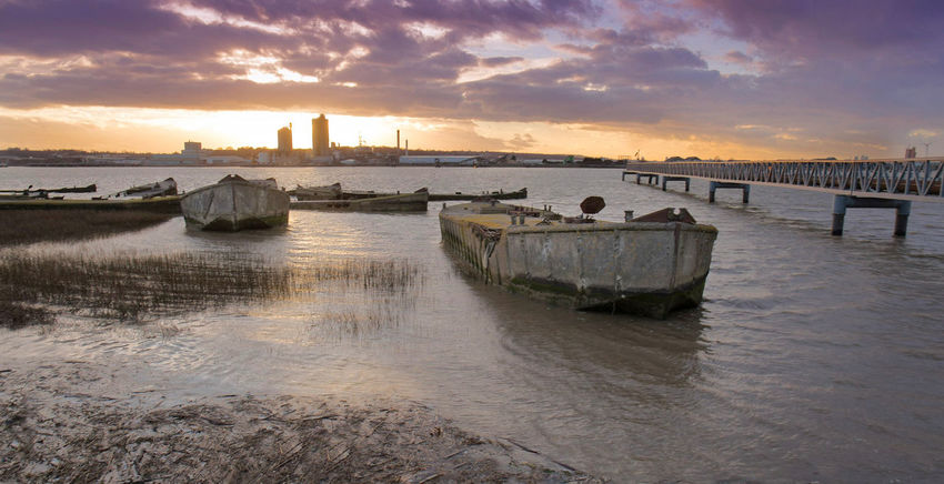 WW2 concrete barges at rest Concrete Barges Thames River Wartime Architecture Sunset Water Riverbank City Travel Destinations Sea No People Horizon Over Water