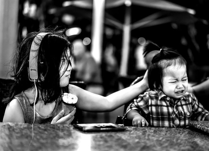 "Capture The Moment ""Its okay brother, i will give you my ice cream"" Blackandwhite Photography Kidsphotography Eyeem Market Mirrorless Black & White"