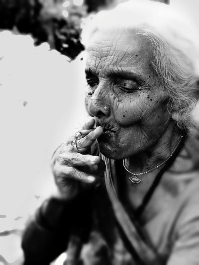 Senior Woman Smoking Beedi