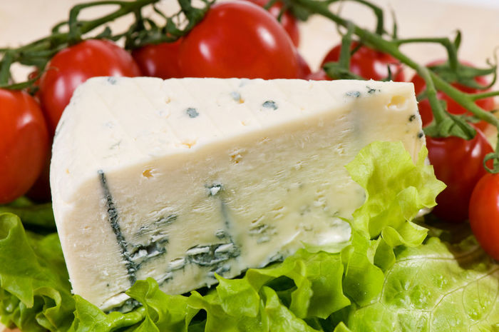 Portion of blue cheese Roquefort and cherry tomatoes lying on green leaf of lettuce, object in horizontal orientation, nobody. Blue Cheese Dairy Edible  Food Lettuce Mold Moldy Mould Mouldy No People Ready-to-eat Roquefort Tomato Tomatoes
