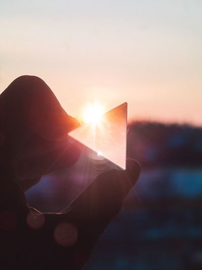 Human Hand Human Finger Sunset Human Body Part Holding Real People One Person Sun Close-up Nature Lifestyles Sky Outdoors Beauty In Nature Day People Prism