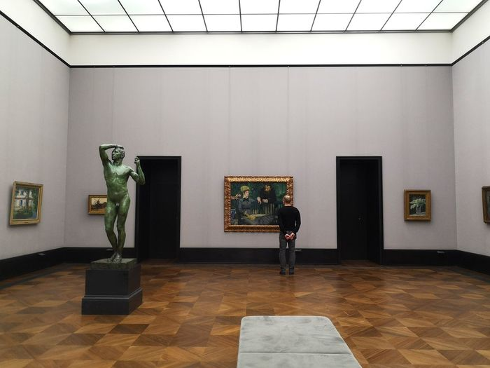 Man standing in front of museum