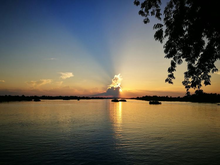 Sunset Water Sky Silhouette Nature Outdoors Cloud - Sky Beauty In Nature Landscape No People Travel Destinations Power In Nature Tree Day 4000 Islands Laos Laos, Lao Trip
