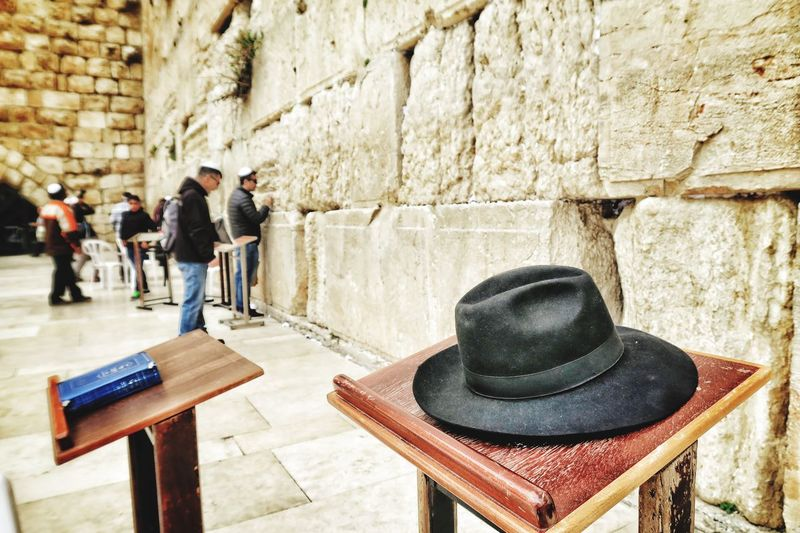 Hat on lectern against wailing wall