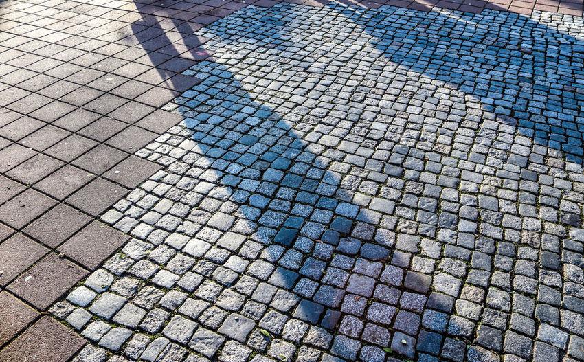 Shadow of people on footpath