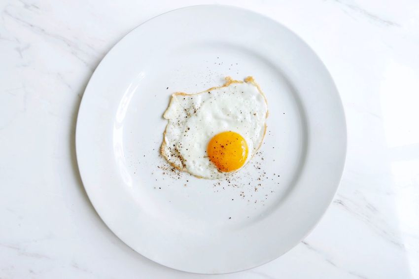 Paint The Town Yellow The Week On EyeEm Egg Plate Food And Drink Food White Color Breakfast Directly Above High Angle View Fried Egg Table No People Indoors  Healthy Eating Egg Yolk Ready-to-eat Freshness Close-up White Background Day