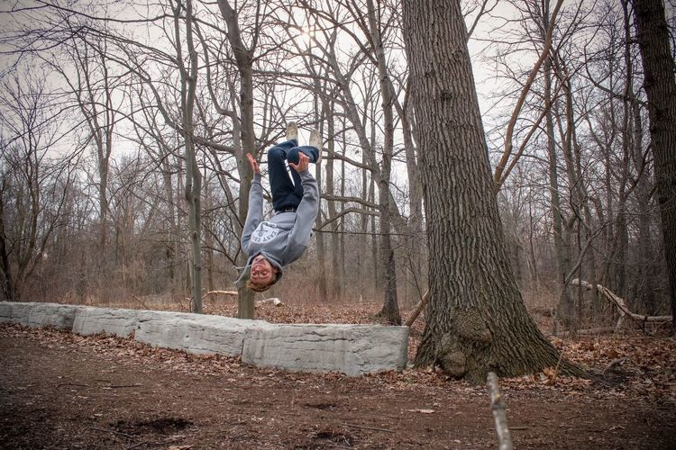 Tree Bare Tree One Person Balance Tree Trunk Full Length Cold Temperature Freedom Flexibility Confidence  Flip Backflip People Jumping One Man Only Nature Adults Only Men Motion Sport Adult