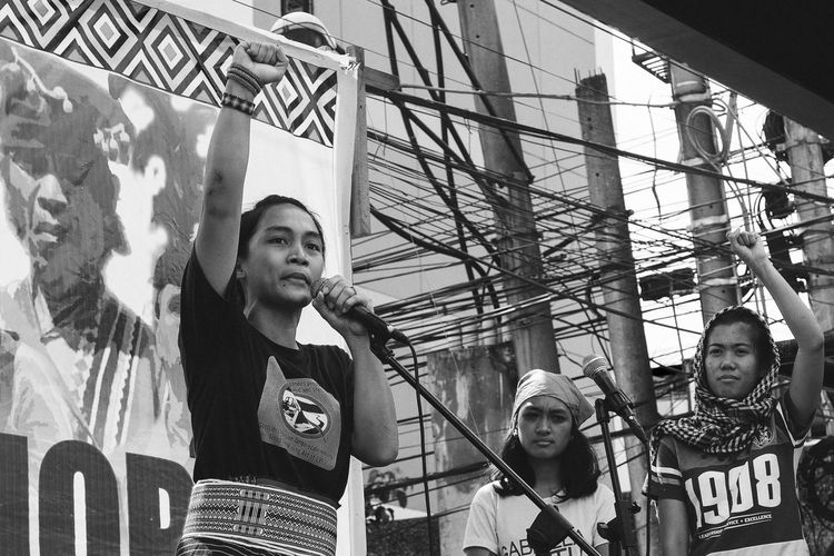 Lakbayan ng Pambansang Minorya 2016 | Piya Macliing Malayao, one of the victims who was ran over by the police van during the anti-US protest. Protest Rally Raised Fist People People Photography People Watching People Of EyeEm People And Places Photojournalism Street Photography Eyeem Philippines Eyeemphoto My Year My View Black And White Black & White Black And White Photography Monochrome Monochrome Photography Noir Lumad Indigenous People Patriotism Women Who Inspire You Women Of EyeEm RePicture Femininity Resist Break The Mold