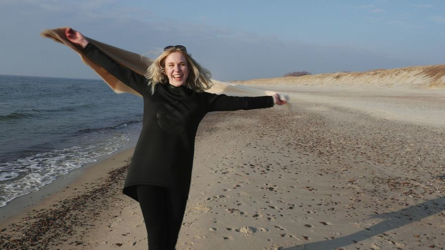 Freedom Inner Power Sand Dune Young Women Blond Hair Portrait Beach Smiling Sand Happiness Looking At Camera Standing Tousled Hair Shore