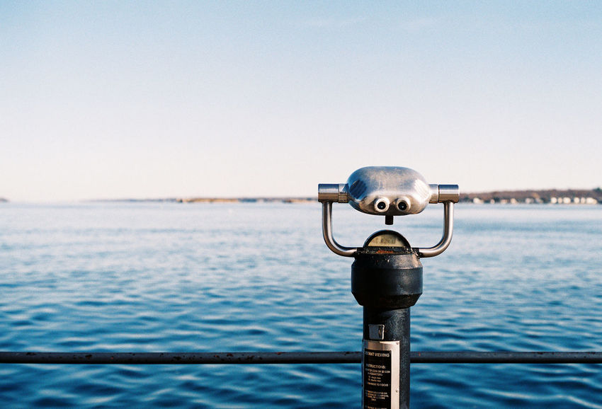 35mm 35mm Film Analogue Photography Analog Canada Clear Sky Close-up Coin-operated Binoculars Day Focus On Foreground Metal Nature No People Outdoors Railing Sea Sky St Lawrence River Water