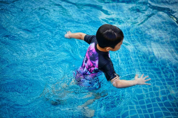 Water Child Swimming Pool Childhood Smiling Swimming Happiness Rear View Wet High Angle View Refraction Swimwear Poolside Swimming Trunks One Piece Swimsuit Back