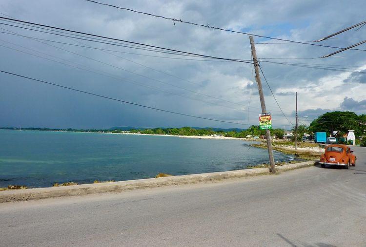 Sky Cloud - Sky Sea Outdoors Power Line  Electricity  Nature Cable No People Water Day Beach Tree Electricity Pylon Architecture Beauty In Nature Beetle Bug VW Cars EyeEm Reggae Road Island Jamaica