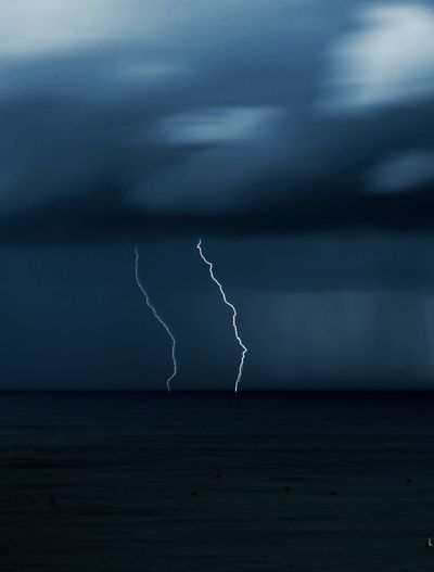 View of lightning over sea