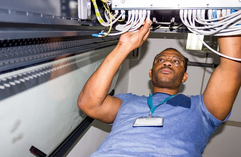 Man working on cable