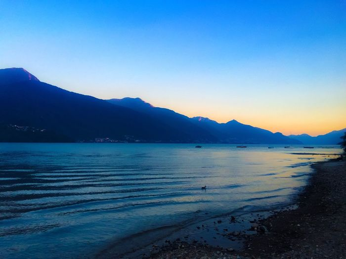 Water Beauty In Nature Scenics Blue Nature Tranquil Scene Tranquility Mountain Sea Beach Idyllic Outdoors Sky Mountain Range No People Clear Sky Sand Day