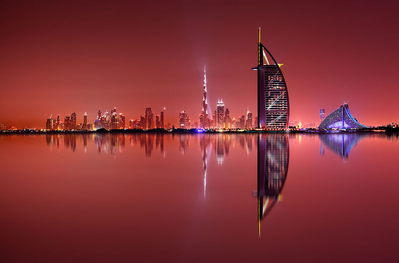 Dubai skyline reflection at amazing night, Dubai, United Arab Emirates Downtown Dubai Nightphotography United Arab Emirates Architecture Building Building Exterior Built Structure City Cityscape Illuminated Landscape Modern Nature Night No People Office Building Exterior Outdoors Reflection Sky Skyscraper Travel Destinations Urban Skyline Water Waterfront The Architect - 2018 EyeEm Awards