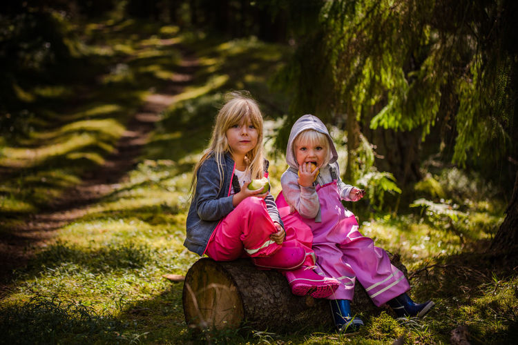Two Children In Forest