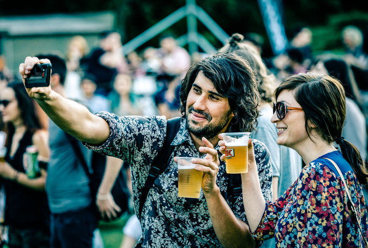 Beer - Alcohol Cheers City Life Communication Friendship Fun Happiness Mobile Conversations People Photographing Photography Themes Portable Information Device Selfie Smart Phone Smiling Togetherness Vacations Young Women