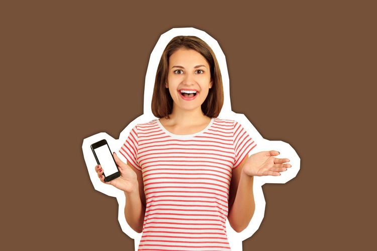 Portrait of a smiling young woman using smart phone