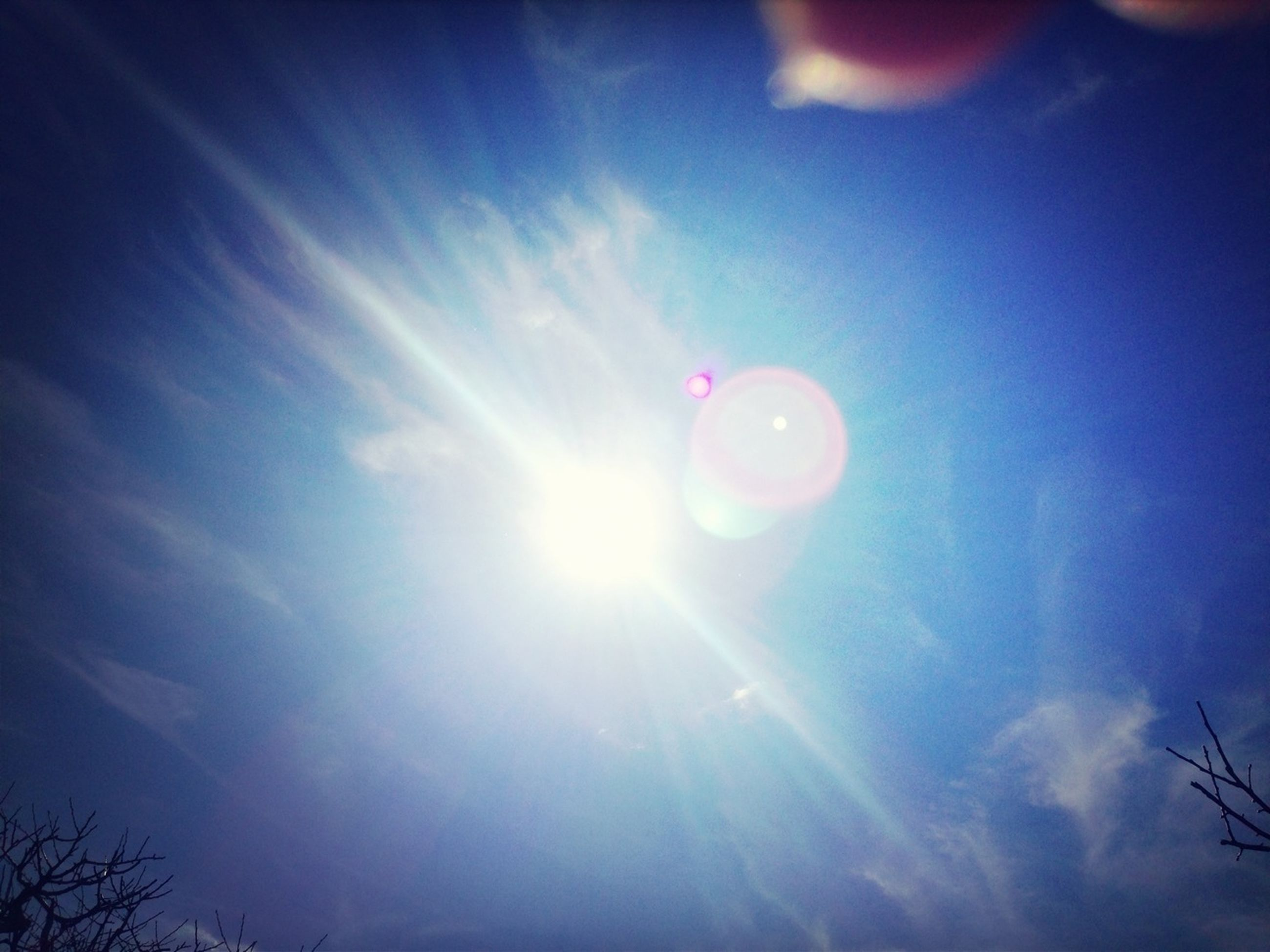 low angle view, sun, sky, lens flare, sunbeam, cloud - sky, blue, beauty in nature, sunlight, tranquility, scenics, nature, bright, tranquil scene, outdoors, sky only, cloud, idyllic, no people, silhouette