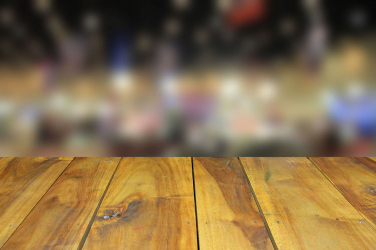 Wooden table and blurred image of motor show,show room,motor expo for background Abstract; Acceleration; Aerial; Auto; Automobile; Automotive; Background; Benz; Blur; Blurred; Bokeh; Business; Car; Color; Concept; Cooper; Crowd; Defocused; Depth; Distribution; Dream; Drive; Exhibition; Exterior; Inside; Interior; Lifestyle; Light; Min Close-up Day Focus On Foreground Indoors  Nature No People Textured  Wood - Material