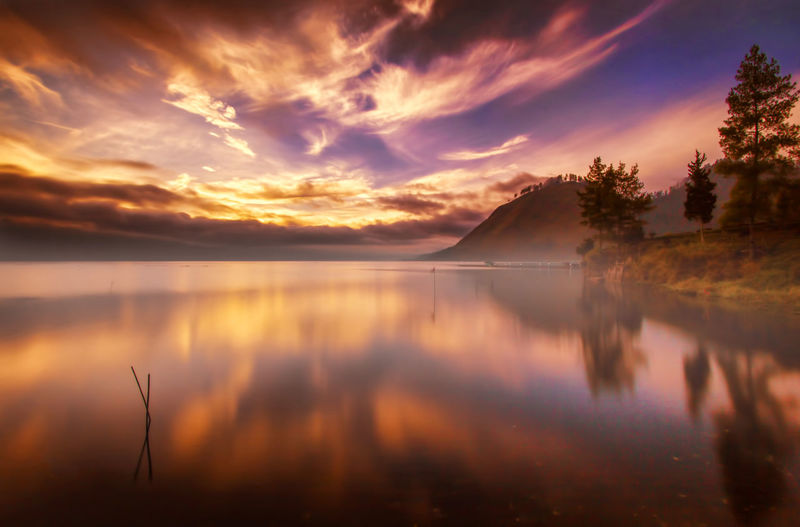 Reflection Sunset Water Lake Scenics Landscape Nature Dawn Idyllic Morning Outdoors Horizon Over Water No People Fog Tranquil Scene Cloud - Sky Tranquility Sky Beauty In Nature Summer