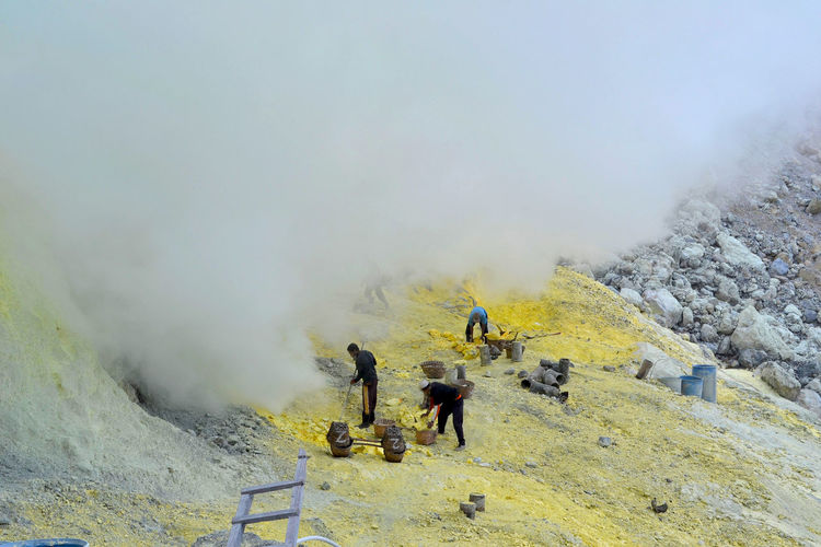 High angle view of people working on mountain