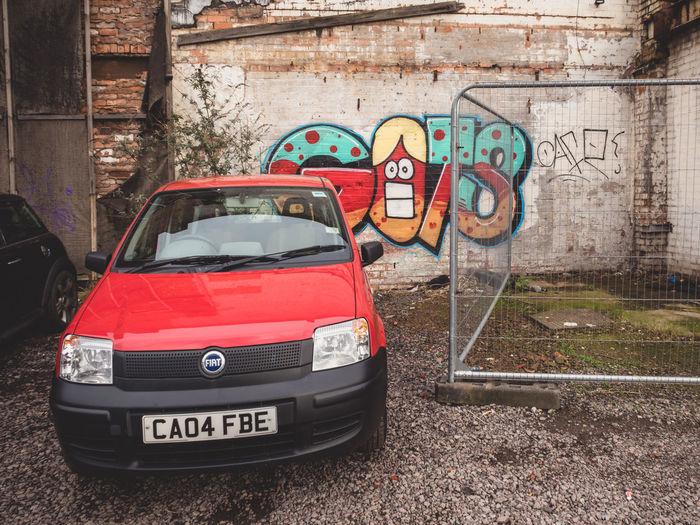 Parked car Wallart Brick Wall Graffiti Derelict EyeEm_abandonment Streetphotography Car Fiat Parked Car