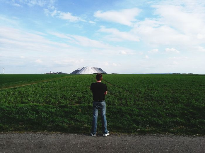 Rear view of man standing on roadside