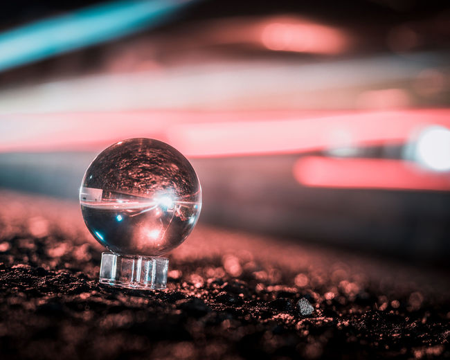 Close-up of illuminated ball with reflection