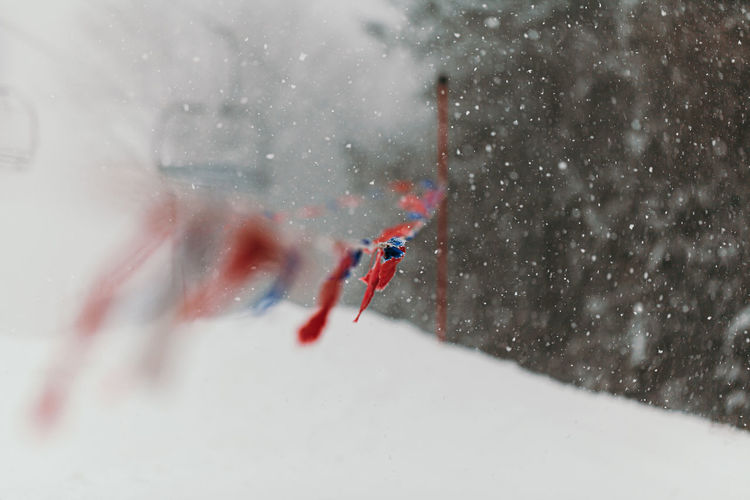 Midsection of person skiing on snow