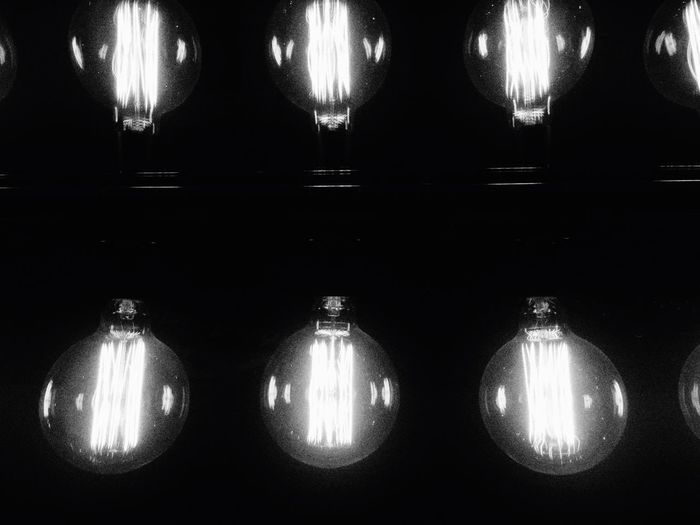 In A Row Lighting Equipment Illuminated Electricity  Light Bulb Indoors  No People Hanging Black Background Night Close-up