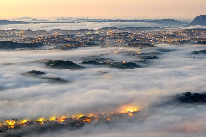 Aerial view of cityscape and cloudscape during sunset
