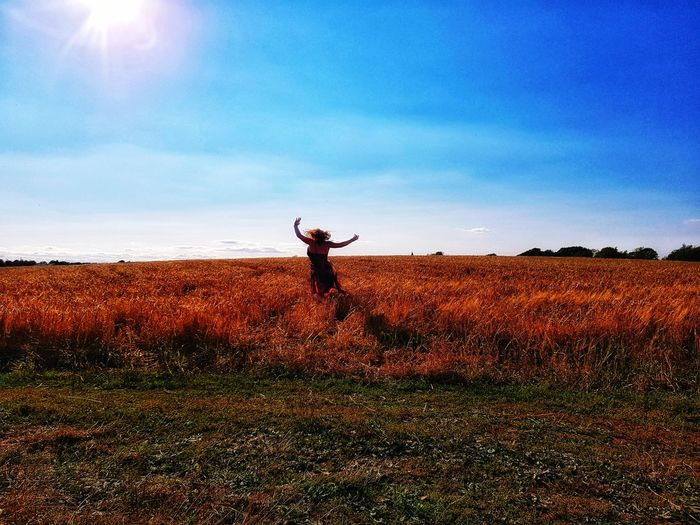 A Taste of Freedom 2 Wheat EyeEmNewHere Hay Field Fields Men Standing Working Agriculture Sky Farmland Arms Raised Agricultural Field Arms Outstretched Cultivated Land Hand Raised Human Arm Human Limb Plough