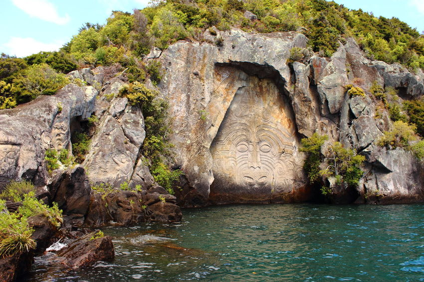 Growth Lake Taupo Maori Sailing Trip Taupo Ancient Civilization Beauty In Nature Day History Landscape Maori Culture Mythology Nature New Zealand No People Outdoors Rock - Object Sky Travel Destinations Water Waterfront Been There. The Great Outdoors - 2018 EyeEm Awards