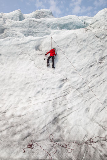 Rear View Of Man Climbing Haugabreen Glacier