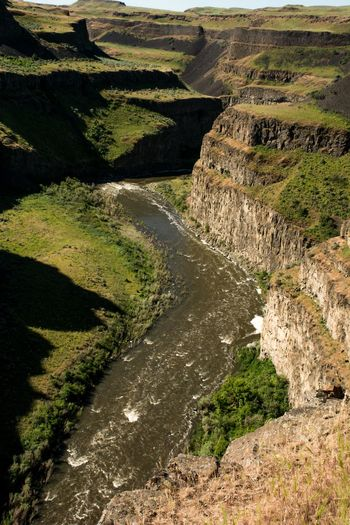 High angle view of river passing through land