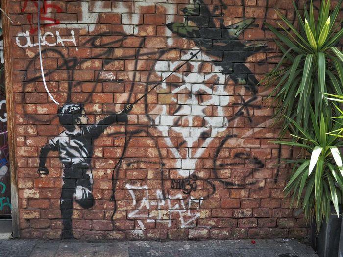 Graffiti on brick wall of building