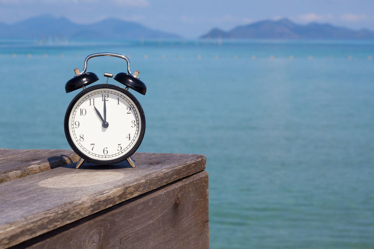 Alam clock with sea background.