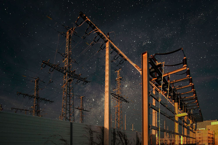Low angle view of a electric construction against sky at night