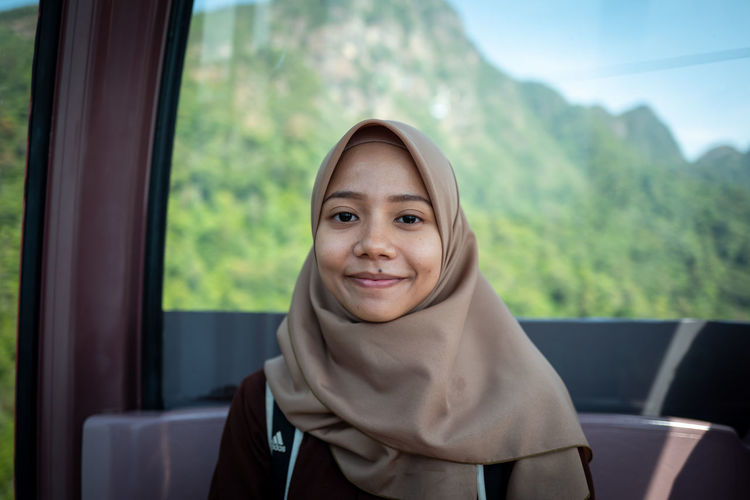 Langkawi Portrait Looking At Camera Smiling One Person Happiness Headshot Window Mode Of Transportation Transportation Emotion Day Lifestyles Travel Focus On Foreground Front View Real People Vehicle Interior Glass - Material Beautiful Woman