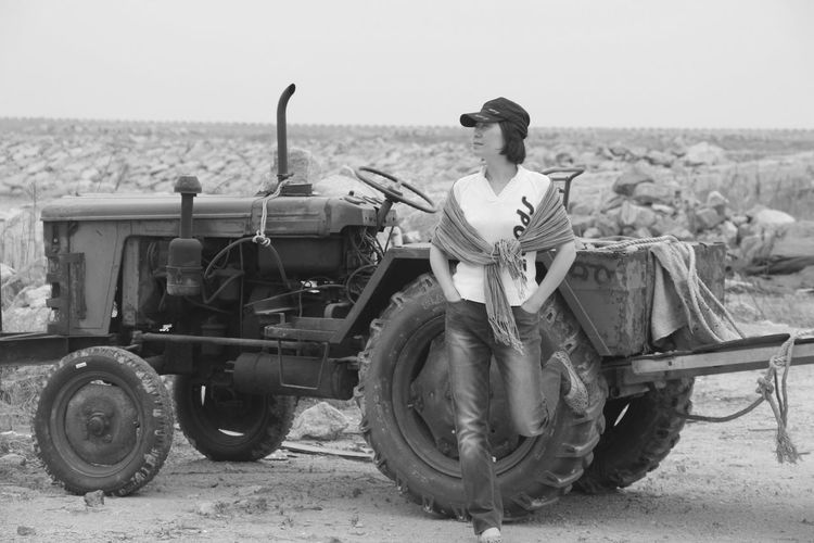 Black & White Black And White Casual Clothing Horizon Over Land Land Vehicle Landscape Lifestyles Mode Of Transport Parked People People Watching Tractor Transportation Woman Woman Portrait Woman Who Inspire You Elegant Elegance Everywhere Monochrome Photography
