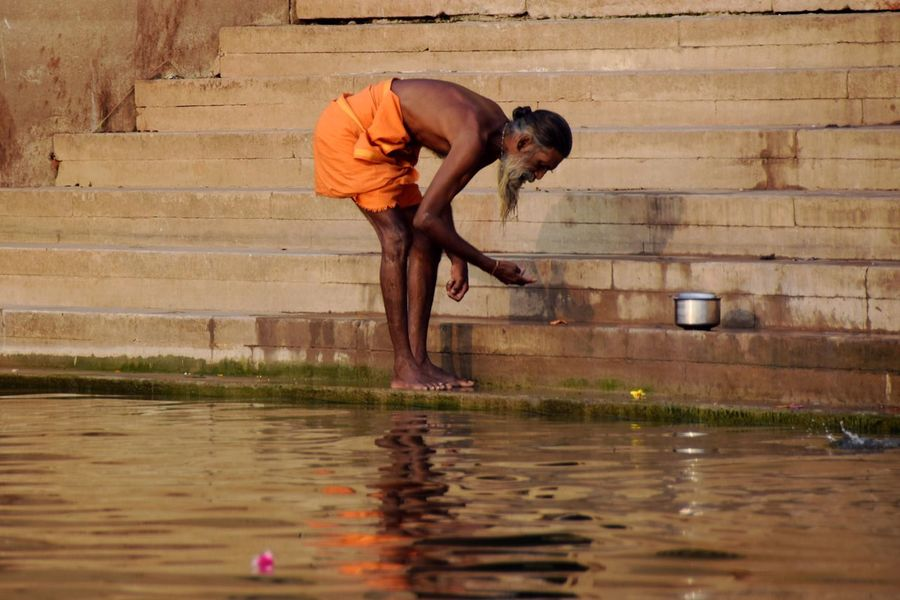 Water Reflection One Person Morning Light Hindu Ceremony Bathing In Ganga Varanasi, India Ganges, Indian Lifestyle And Culture, Bathing In The Ganges, Hinduism Adult Bathing Ritual India Indian Varanasi Ganges Hindu Culture Real People Indian Culture  Hindu Indianphotography Indian Culture  Ceremony Cultures